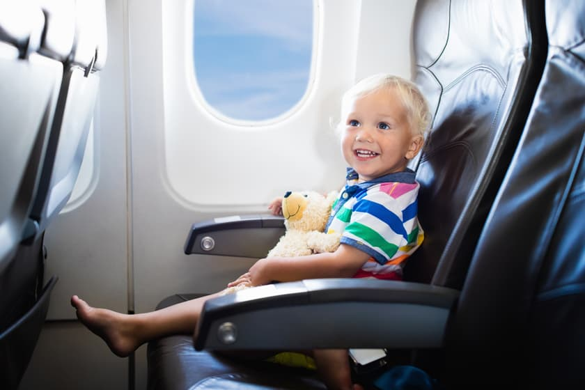 Happy child in airplane. Going on a family travel vacation.