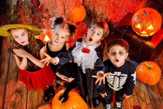 kids all dressed up for a Halloween party for trick-or-treating alternative
