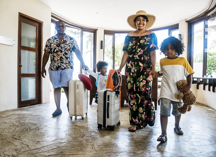 family checking into one of the best all-inclusive family resorts