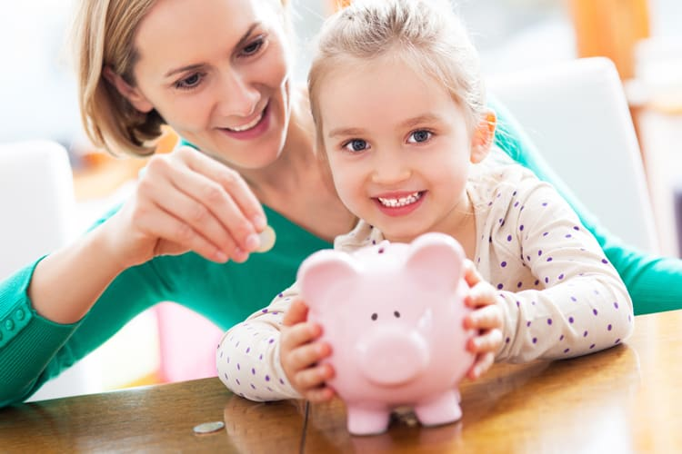 adding money to piggy bank