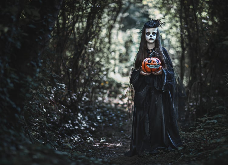 haunted girl holding pumpkin in a haunted forest ghost tours