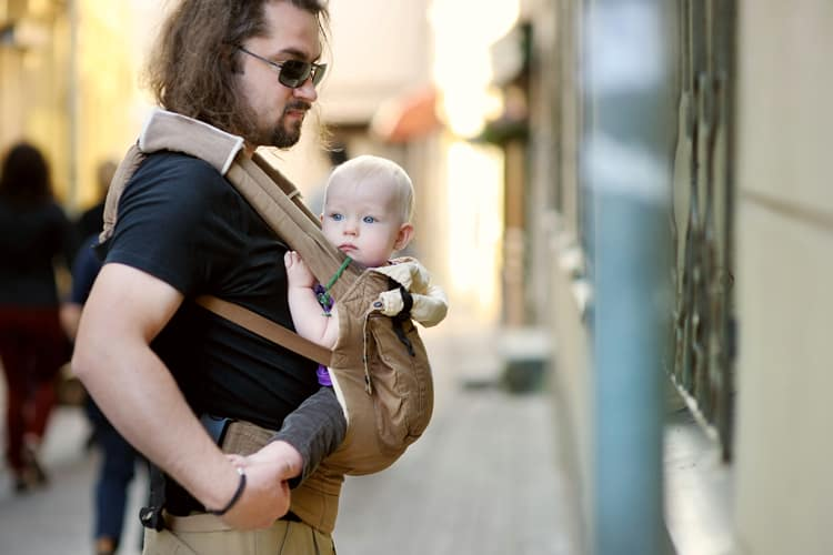 father with baby travel companion at museum