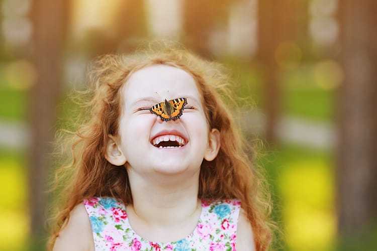 little girl with butterfly on her nose in miami
