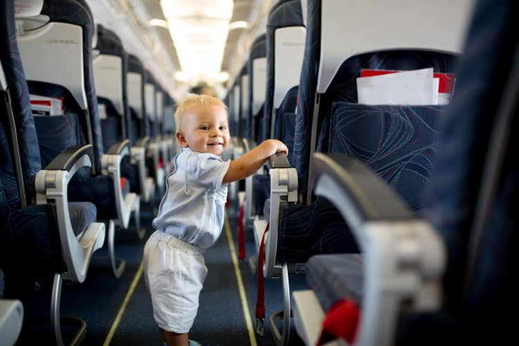 little boy following airline rules in airplane