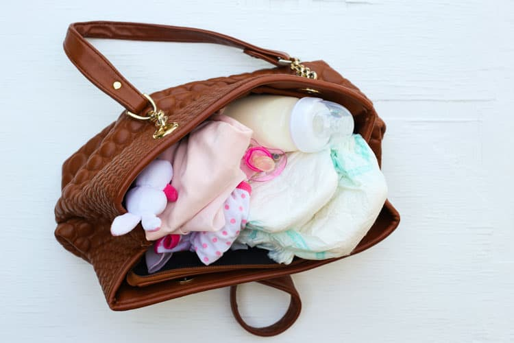 packed diaper bag following airline rules for flying with breastmilk