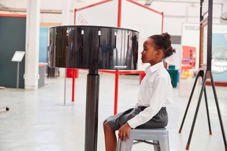 girl watching zoetrope at children's museum