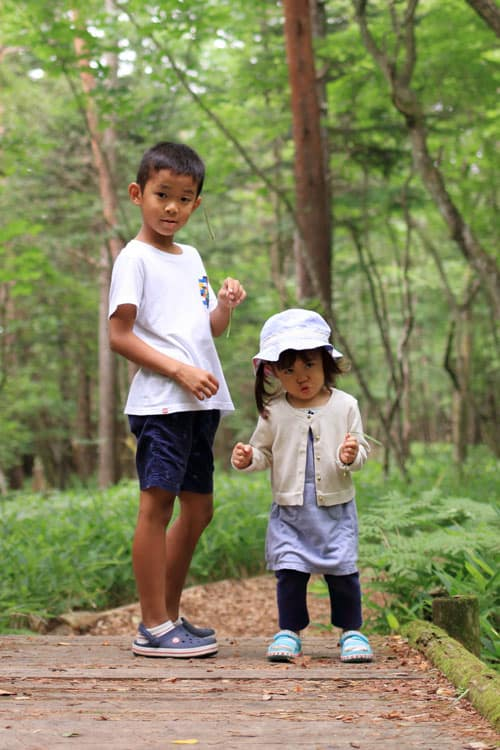 two children backpacking and hiking