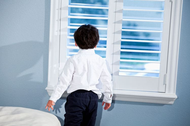 child standing at the window