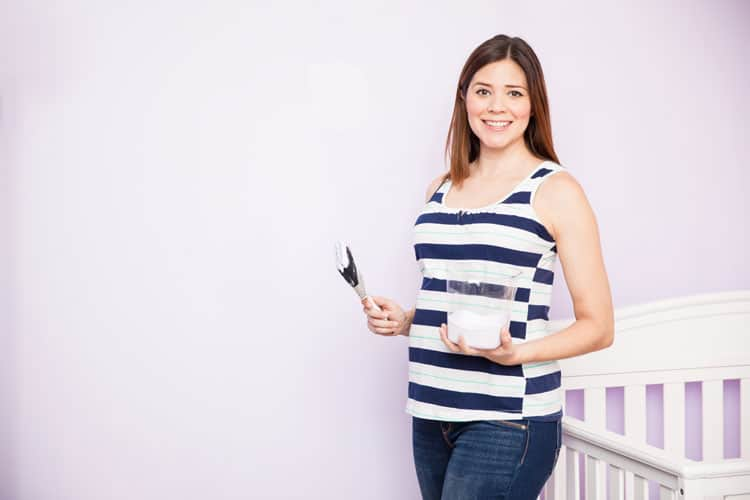 pregnant women painting walls