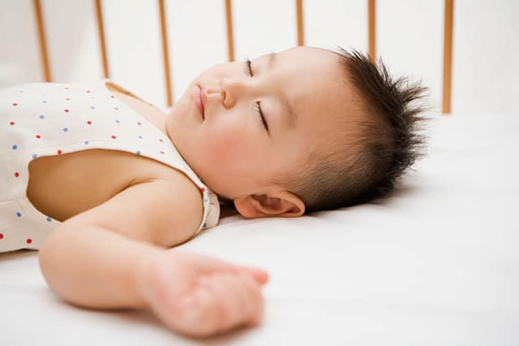 child sleeping in a crib