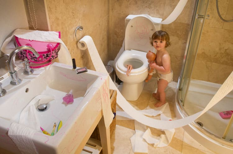 child making a mess in the bathroom