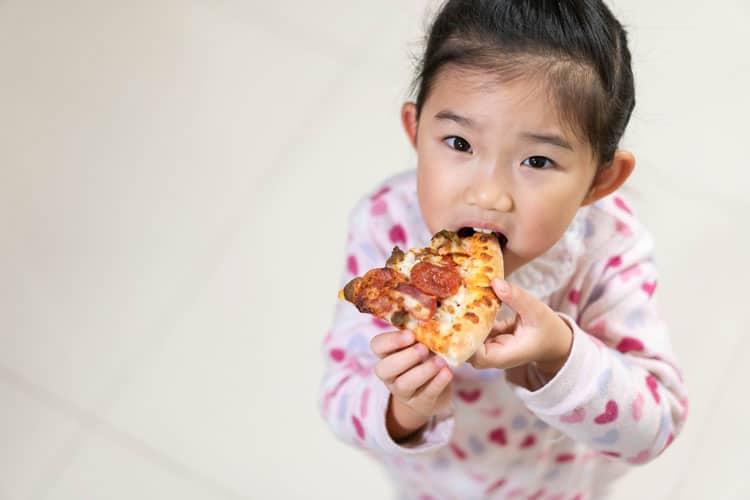 girl eating pizza at Bay Area Discovery Museum