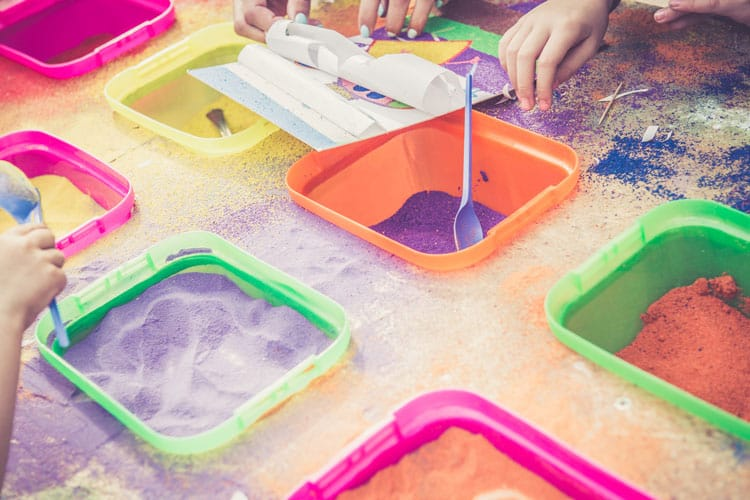 colored sand in containers