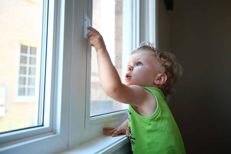 child trying to unlock a window
