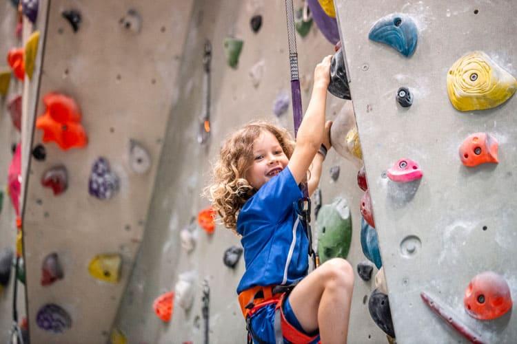 child on rock climbing wall