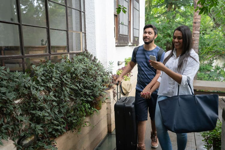 couple entering their airbnb